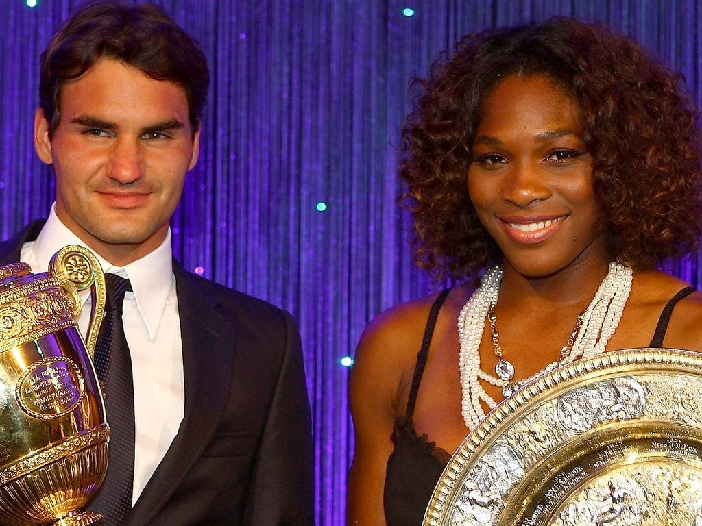 Roger Federer of Switzerland and Serena Williams of United States hold their Trophies at the Hotel Intercontinental on July 5, 2009 in London, England. (Photo by Julian Finney/Getty Images)