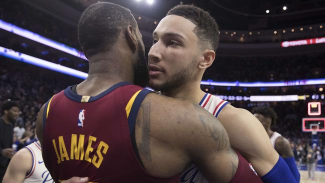LeBron James and Ben Simmons embrace.