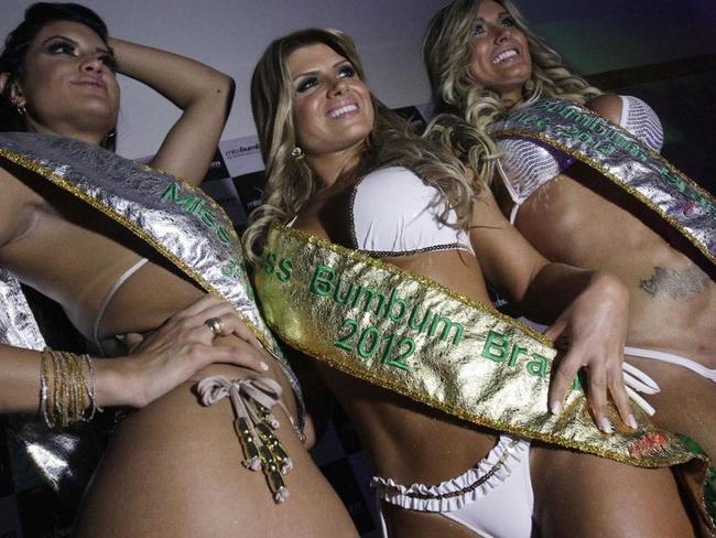 First place winner Carine Felizardo, centre, third place winner Camila Vernaglia, left, and second place winner Andressa Urach in the 2012 competition. Picture: AP