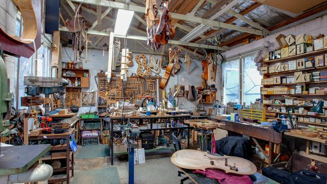 The woodworking shed at the rear where Mr Williams has created dozens of instruments.