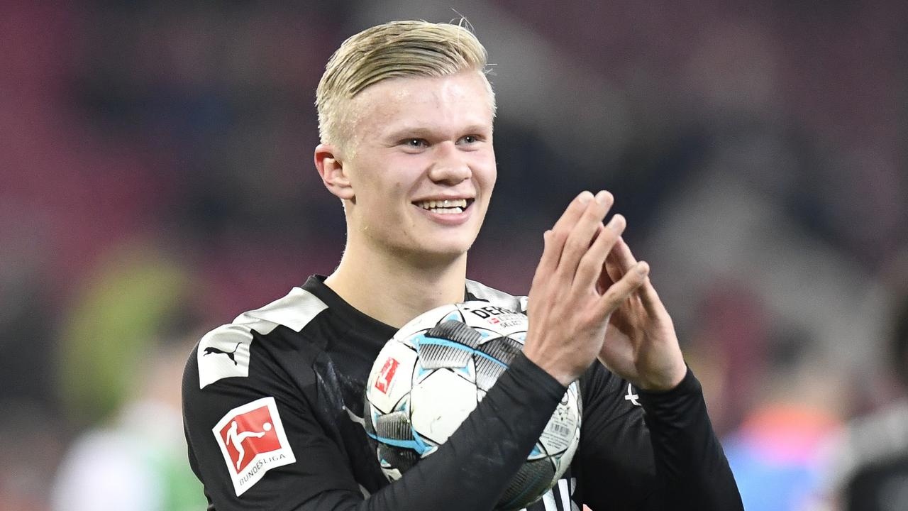 A match ball to cherish forever: Erling Braut Haaland after his debut hat-trick.