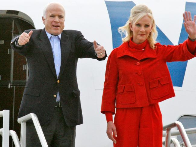 Republican US presidential candidate Senator John McCain accompanied by his wife Cindy. Picture: AFP