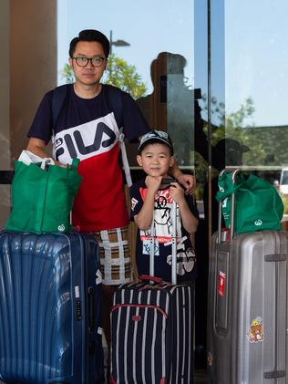 Opal Tower resident Haiping pictured with his son Gordon Wang, 6, after they were forced out for 48 hours. Picture: Monique Harmer