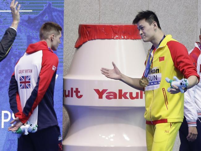 Sun Yang confronts Britain's Duncan Scott after he refused to stand alongside Sun on the podium.