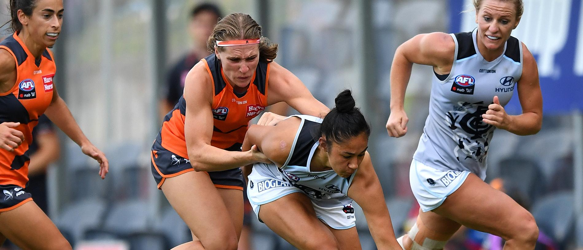 Darcy Vescio of the Blues and Pepa Randall of the Giants during the Round 3 AFLW match between the GWS Giants and the Carlton Blues at Blacktown International Sportspark in Sydney, Saturday, February 16, 2019. (AAP Image/Dylan Coker) NO ARCHIVING, EDITORIAL USE ONLY