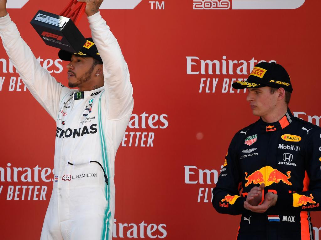 Mercedes' British driver Lewis Hamilton (C), first placed, Mercedes' Finnish driver Valtteri Bottas (L), second placed, and Red Bull's Dutch driver Max Verstappen, third placed, celebrate on the podium of the Spanish Formula One Grand Prix at the Circuit de Catalunya in Montmelo in the outskirts of Barcelona on May 12, 2019. (Photo by LLUIS GENE / AFP) (Photo credit should read LLUIS GENE/AFP via Getty Images)