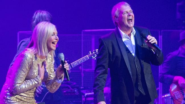 Two strong hearts ... Farnsey loving Livvy at Rod Laver Arena. Pic Stuart Walmsley