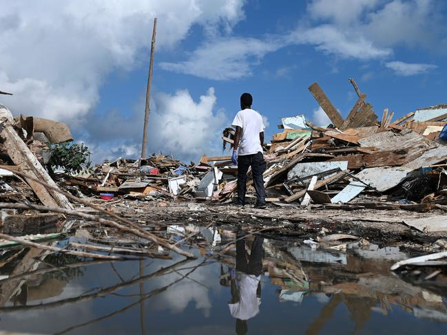 A man walks through the debris in Marsh Harbour, Bahamas. Picture: AFP