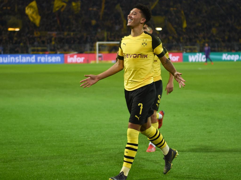 Dortmund's English midfielder Jadon Sancho celebrates scoring their team's second goal during the German first division Bundesliga football match Borussia Dortmund vs Bayer Leverkusen on February 24, 2019 in Dortmund. (Photo by Patrik STOLLARZ / AFP) / DFL REGULATIONS PROHIBIT ANY USE OF PHOTOGRAPHS AS IMAGE SEQUENCES AND/OR QUASI-VIDEO