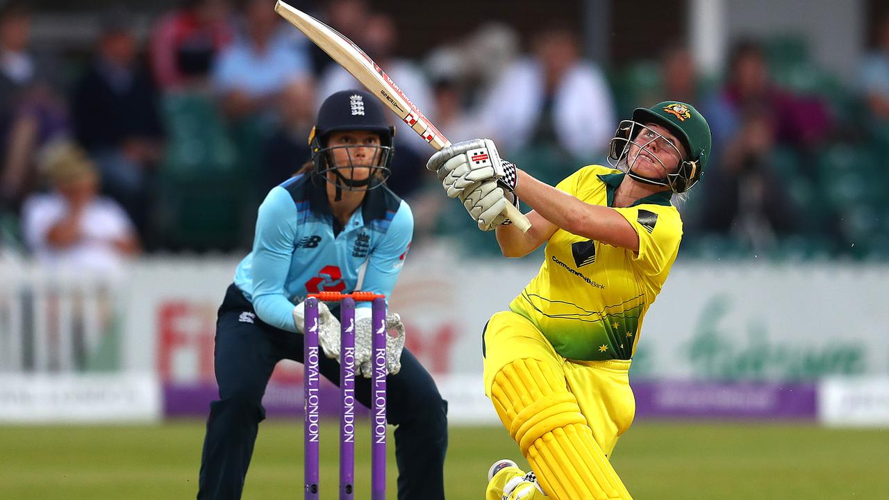 Jess Jonassen launches a ball to the boundary. (Photo by Matthew Lewis/Getty Images)