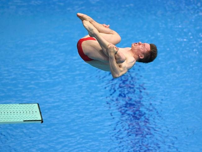 Germany's Martin Wolfram competes in the men's 3m springboard diving event.