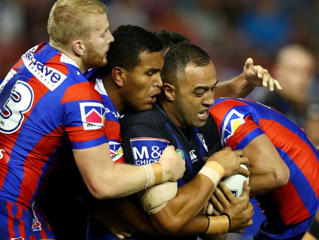 Bulldog prop Sam Kasiano wrapped up by the defence.