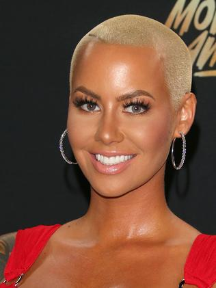Model Amber Rose shaved her head because of Sinead O'Connor. (Photo: Jean Baptiste Lacroix)