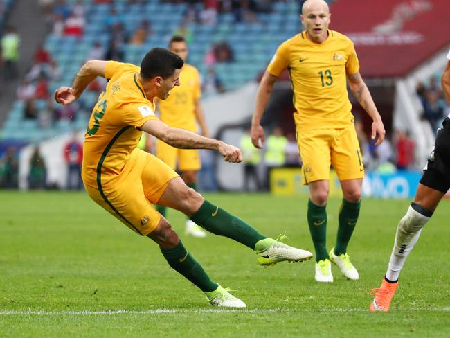 Tommy Rogic of Australia scores.