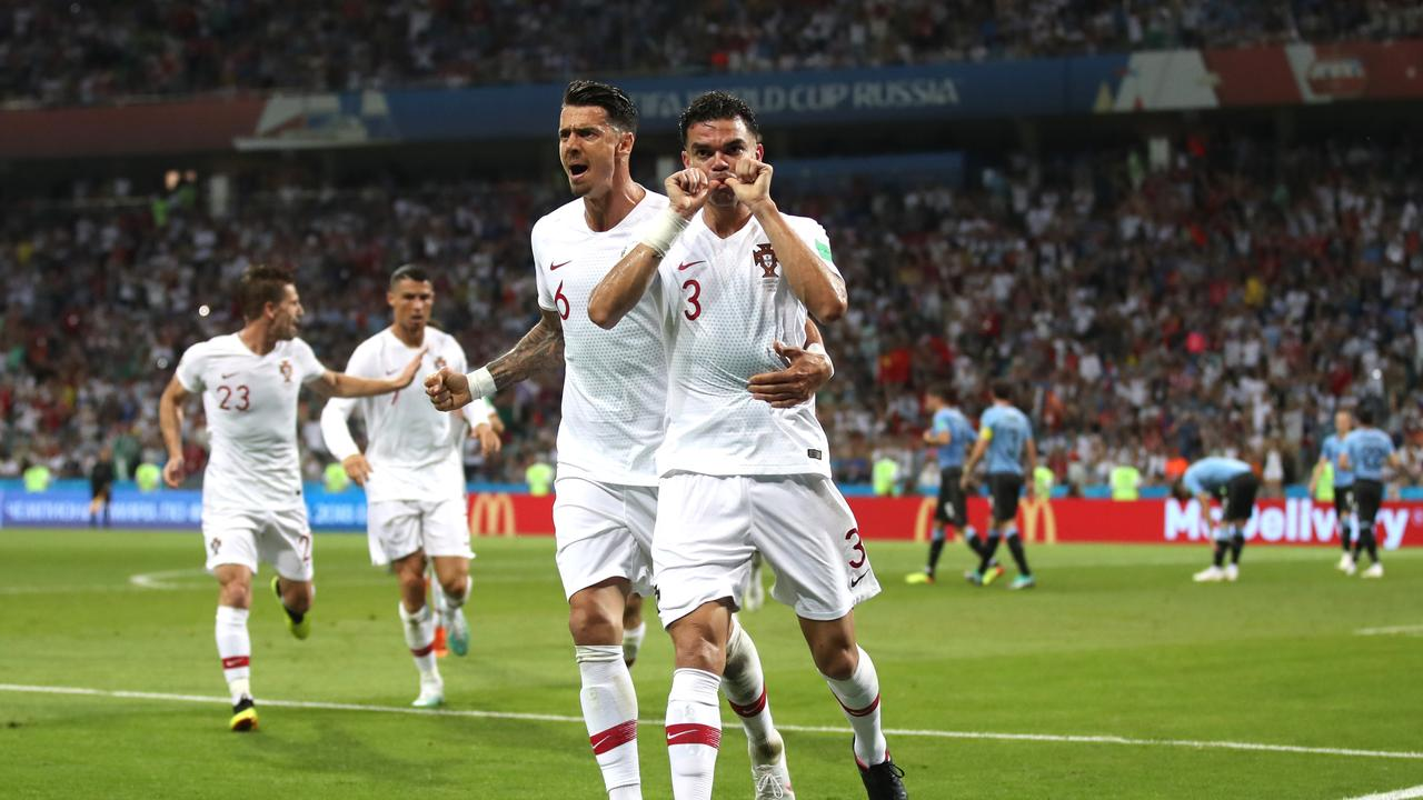 Pepe of Portugal celebrates after scoring his team's first goal with team mate Jose Fonte