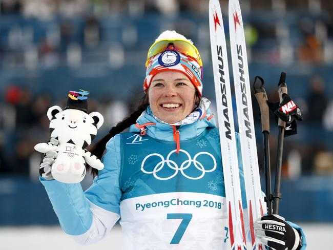 Bronze medal winner Krista Parmakoski, of Finland, poses during the winners ceremony after the women's 7.5km skiathlon cross-country skiing competition. picture: Picture: Matthias Schrader/AP