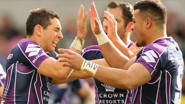 Billy Slater celebrates one of his two tries in the Storm's win over the Eels.