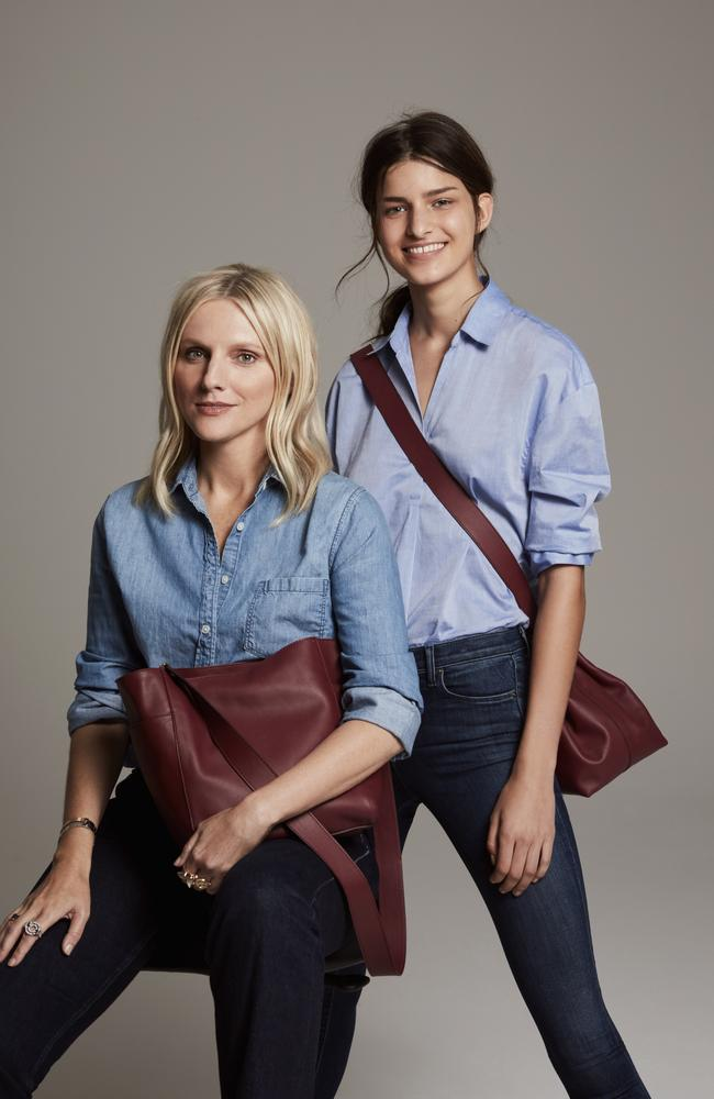 Laura Brown, pictured left, with one of her Mone Purse designs. Picture: Supplied