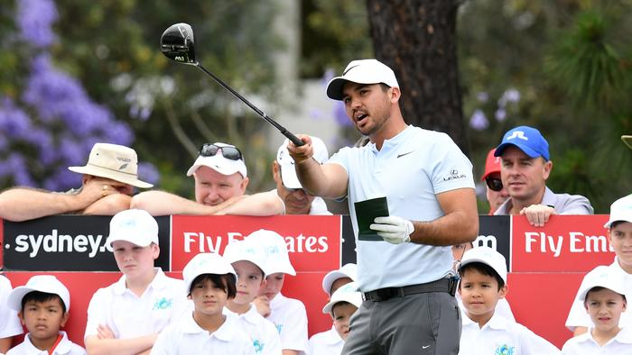 Jason Day of Australia tees off as he holds a golf clinic for children on the 18th fairway during a practice round ahead of the Australian Open Golf championship at The Australian Golf Club in Sydney, Tuesday, November 21, 2017. (AAP Image/Dean Lewins) NO ARCHIVING, EDITORIAL USE ONLY