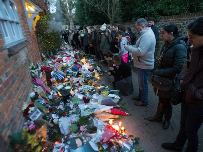 Mourners leave candles, cards and flowers at the Oxfordshire home of British singer George Michael, where he was found dead. Picture: AFP/Daniel Leal-Olivas
