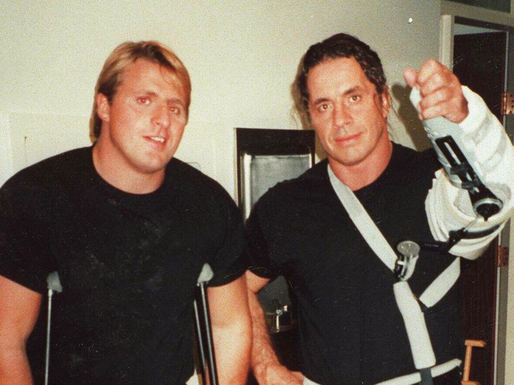 Wrestler Owen Hart (L) in undated photo with wrestling brother Bret.