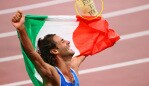 TOKYO, JAPAN - AUGUST 01: Gianmarco Tamberi of Team Italy celebrates after agreeing to share gold with Mutaz Essa Barshim of Team Qatar in the Men's High Jump Final on day nine of the Tokyo 2020 Olympic Games at Olympic Stadium on August 01, 2021 in Tokyo, Japan. (Photo by Abbie Parr/Getty Images)