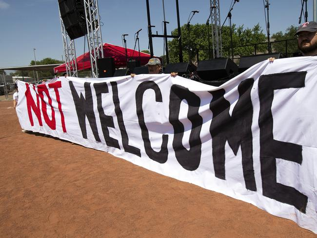 Demonstrators hold a banner to protest the visit ofUS President Donald Trump to the border city of El Paso, Texas. Picture: AP
