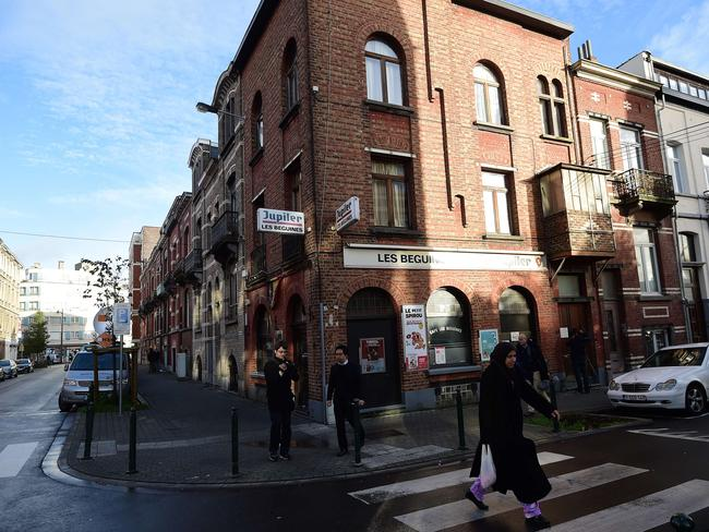 "Family ties ... A woman walks past the ""Les Beguines"" bar in Brussels's Molenbeek district, owned by Ibrahim Abdeslam, one of three brothers implicated in Paris attacks. Source: AFP"