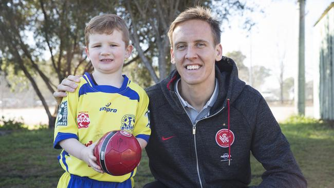 Michael Thwaite hosted a miniroos Gala Day at Werrington. Pictured is Mitchell Atkin 4 showing Thwaite some skills.