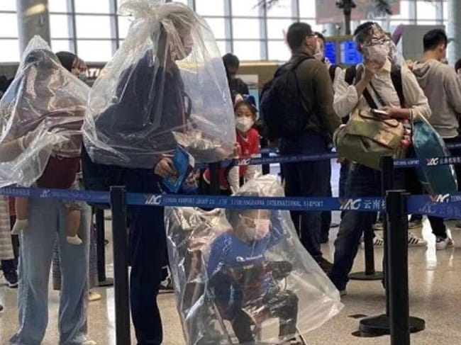 This family weren't taking any chances, opting for the full body plastic bag coverings. Picture: Supplied