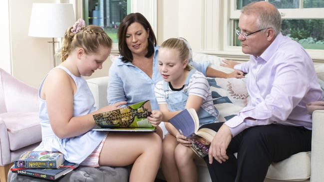 Prime Minister Scott Morrison, his wife Jenny and two daughters Lily, 9, and Abbey, 11, read together at home at Kirribilli House. Picture: Darren Leigh Roberts