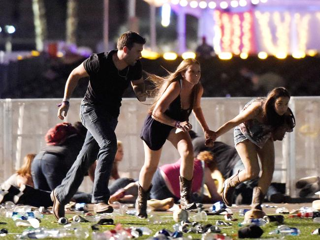 "People run for their lives after a ""popping"" sound turns out to be semi-automatic gunfire. Picture: David Becker/Getty Images/AFP"