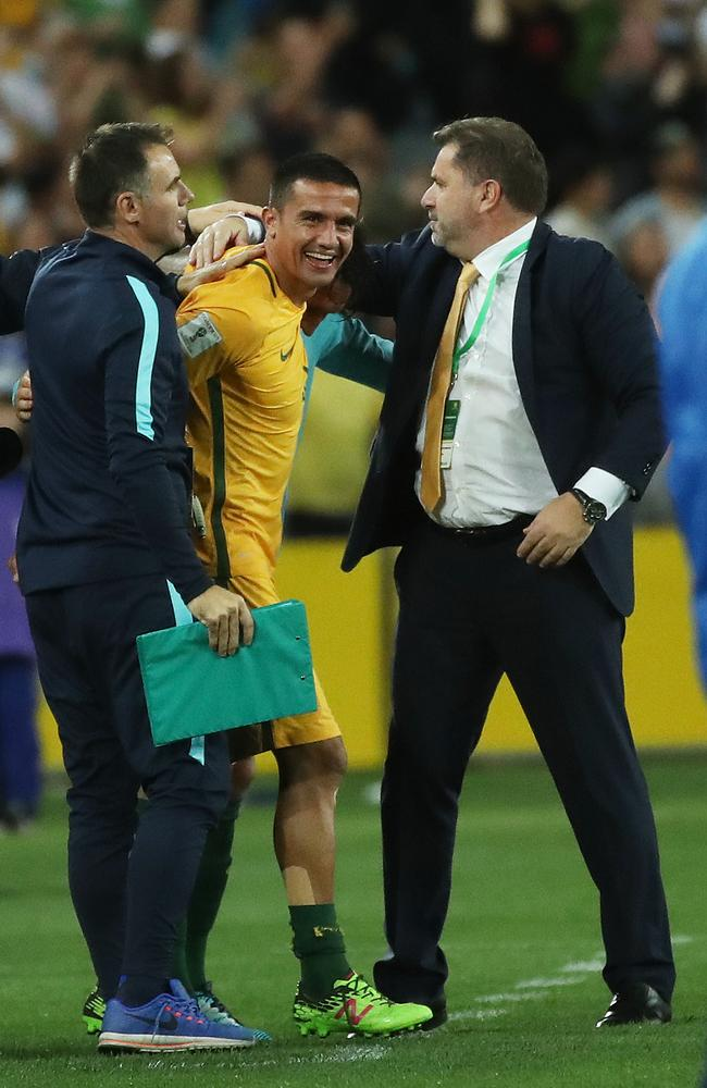Tim Cahill and Ange Postecoglou on the final whistle against Honduras.