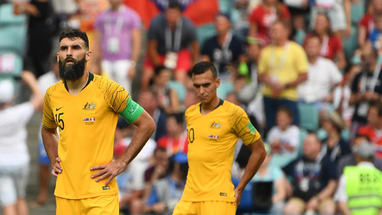 Jedinak and Sainsbury react after the defeat to Peru.