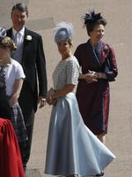 Sophie, Countess of Wessex arrives followed by Princess Anne, Princess Royal (R) and Vice Admiral Timothy Laurence for the wedding ceremony of Britain's Prince Harry and US actress Meghan Markle at St George's Chapel, Windsor Castle on May 19, 2018 in Windsor, England. Credit: Odd ANDERSEN - WPA Pool/Getty Images