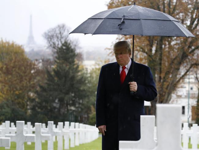 President Donald Trump stands among the headstones during an American Commemoration Ceremony in Paris on Sunday. Picture: AP Photo/Jacquelyn Martin