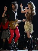 <p>Taylor Swift and guitarist Grant Mickelson perform live on stage at The Burswood Dome on March 2, 2012 in Perth, Australia. (Photo by Paul Kane/Getty Images)</p>