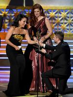 Julia Louis-Dreyfus accepts Outstanding Lead Actress in a Comedy Series for 'Veep' from actor Debra Messing and TV personality Chris Hardwick onstage during the 69th Annual Primetime Emmy Awards at Microsoft Theater on September 17, 2017 in Los Angeles, California. Picture: Getty
