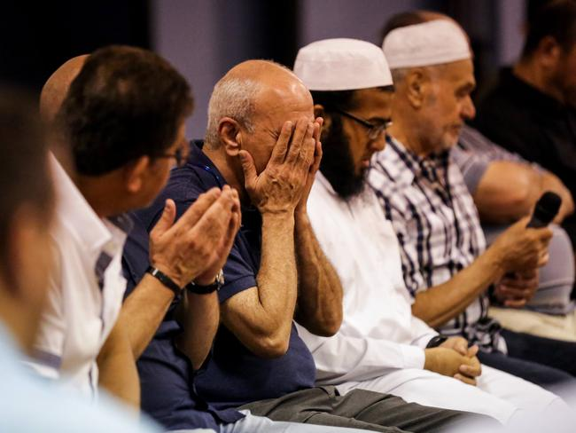 A prayer wake and reading for Ms Maasarwe was held at Melbourne's UMMA mosque with the woman's father Saeed (above, in blue shirt) attending. Picture: Nicole Cleary.
