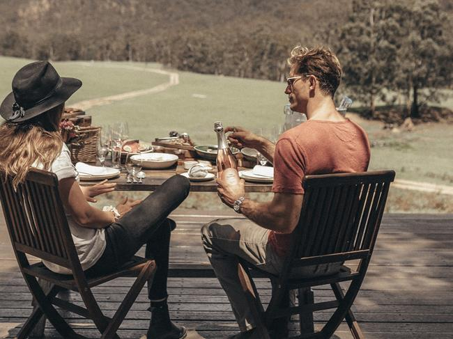 A couple dine at the NSW luxury resort in Wolgan Valley.