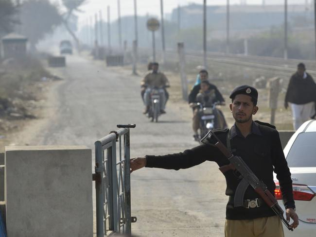 A Pakistani policeman stands guard outside the check pint of Kot Lakhpat Jail where the suspect was taken. Picture: AFP