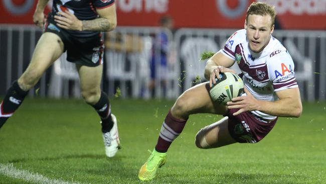 Daly Cherry-Evans runs in to score.