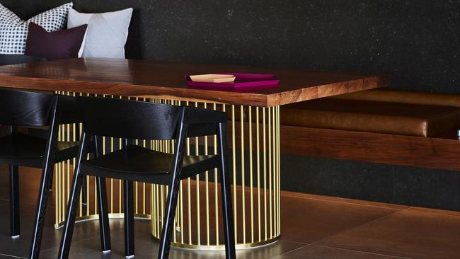 Builtin benchseats and a twist of gold as part of the extended kitchen. Picture: Supplied.