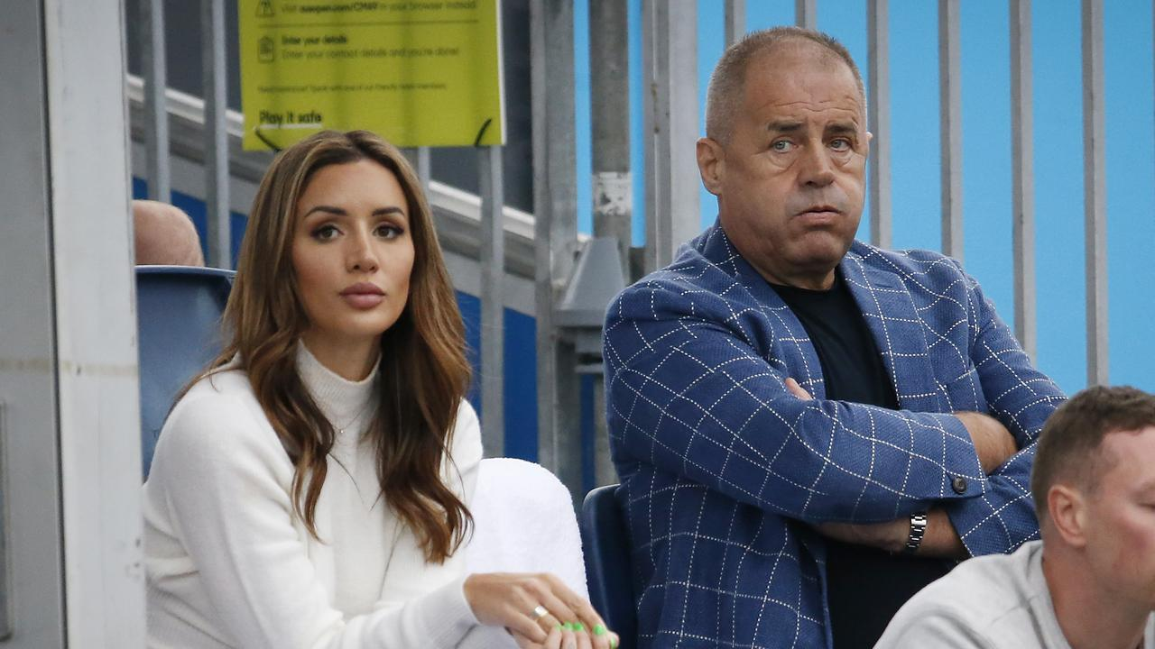 Tomic's girlfriend Vanessa Sierra and his father John Tomic. Picture: David Caird