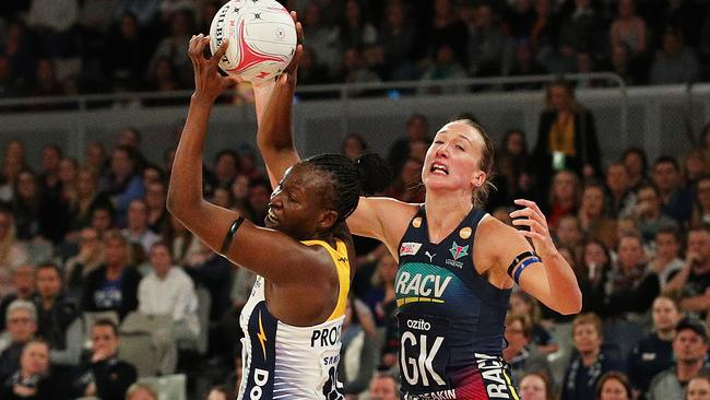 Peace Proscovia of the Lightning (L) competes for the ball