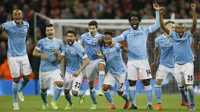 Manchester City players celebrate after winning the English League Cup final