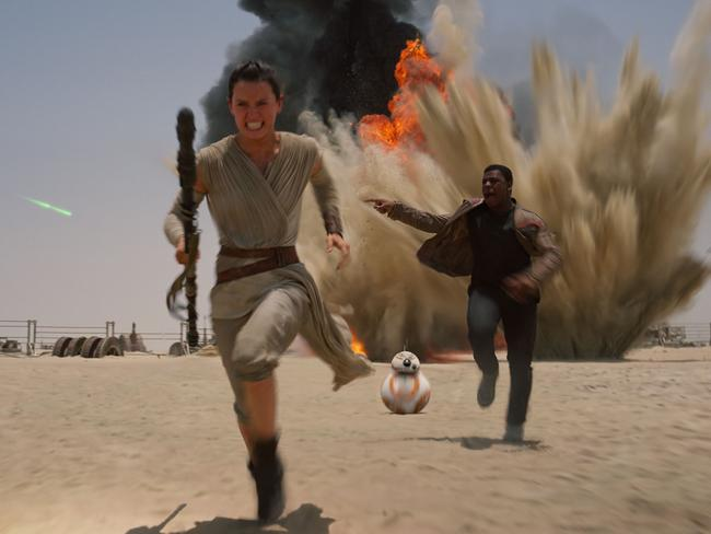 Tough ... Daisey Ridley as Rey, left, and John Boyega as Finn, in a scene from Star Wars: The Force Awakens. Picture: Film Frame/Disney/Lucasfilm via AP