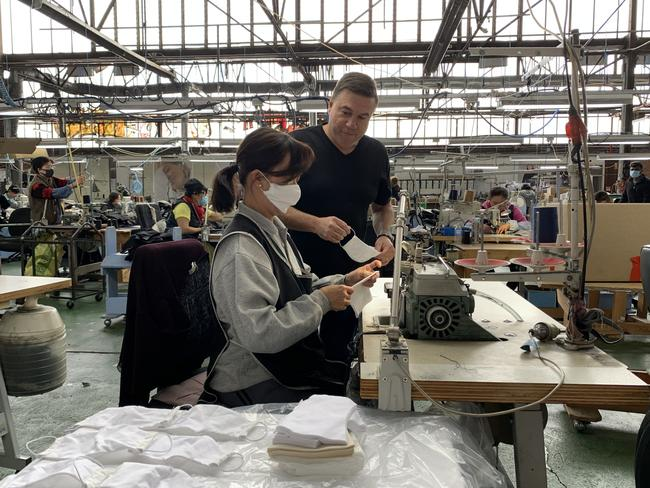 Nobody Denim co-founder John Condilis with a garment worker inside Nobody Denim's Melbourne factory. The brand is developing prototypes to manufacture masks amind coronavirus. Picture: Nobody