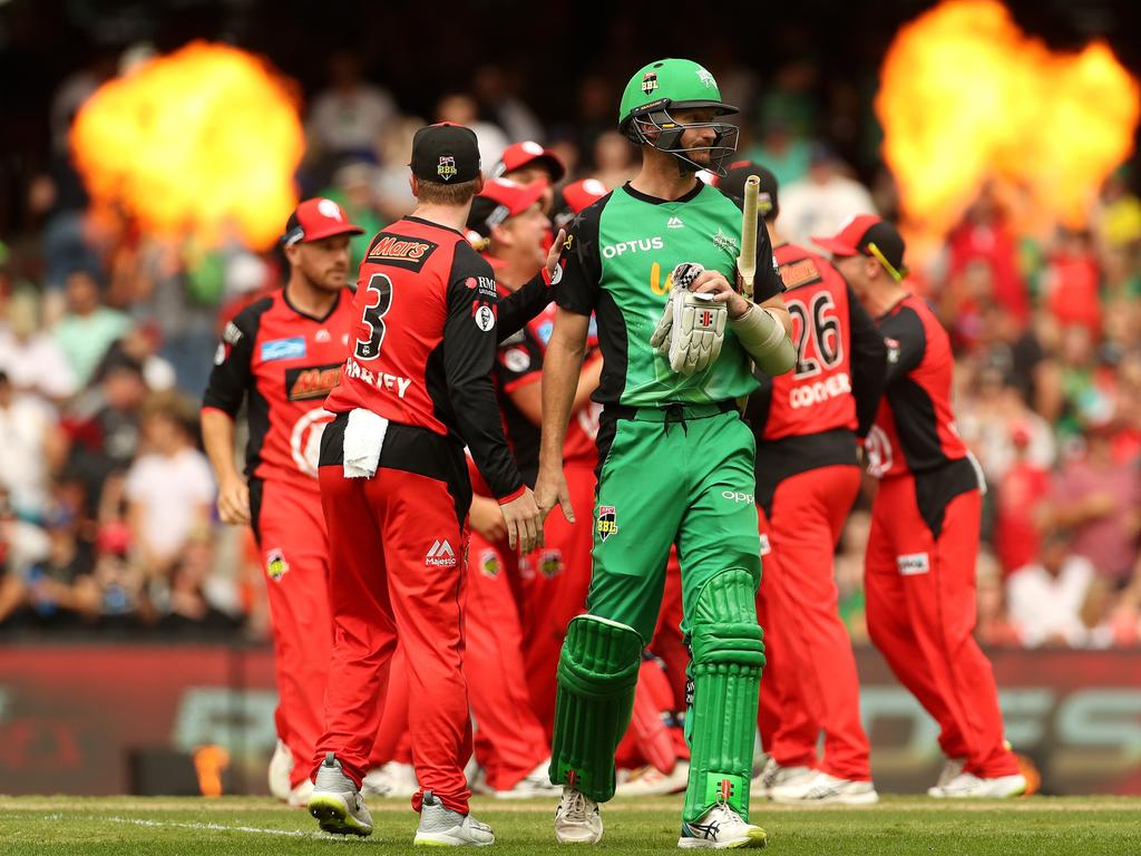Jackson Bird of the Stars walks off as the Renegades celebrate their win during the Big Bash League (BBL) match final between the Melbourne Renegades and the Melbourne Stars at Marvel Stadium in Melbourne, Sunday, February 17, 2019. (AAP Image/Mark Dadswell) NO ARCHIVING, EDITORIAL USE ONLY