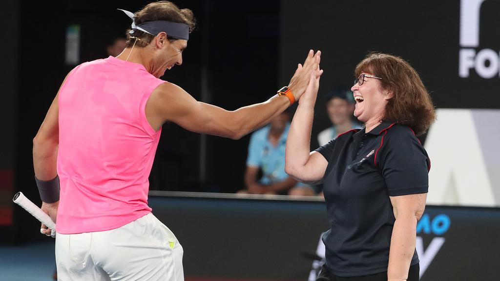 Rafael Nadal clashes the five with his partner, CFA firefighter Deb Borg. Image: Michael Klein